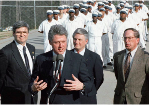 "Bill Clinton announces his ""tough on crime"" agenda during the 1992 presidential campaign at the state prison at Stone Mountain, Georgia, the spiritual home and 1915 birthplace of the second Ku Klux Klan."